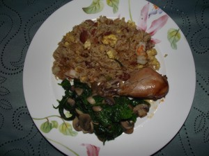 chicken drumstick with fried rice and spinach